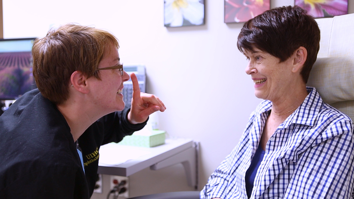 University of Iowa ocularist Lindsay Pronk with a patient during a prosthetic fitting