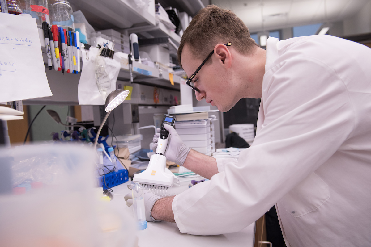 University of Iowa student Jesse Cochran works in the lab