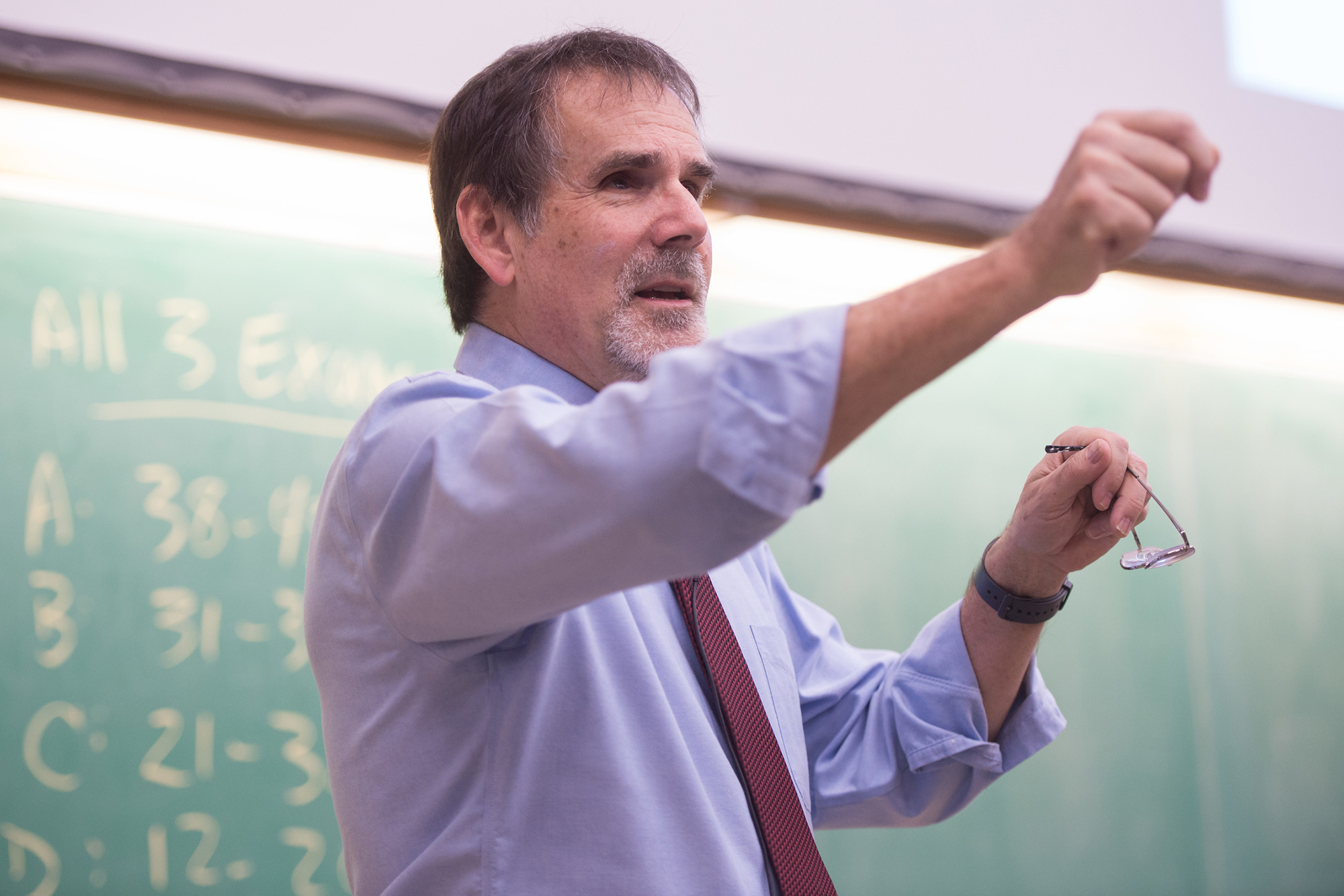 university of iowa physics and astronomy faculty member Craig Kletzing at the front of a classroom