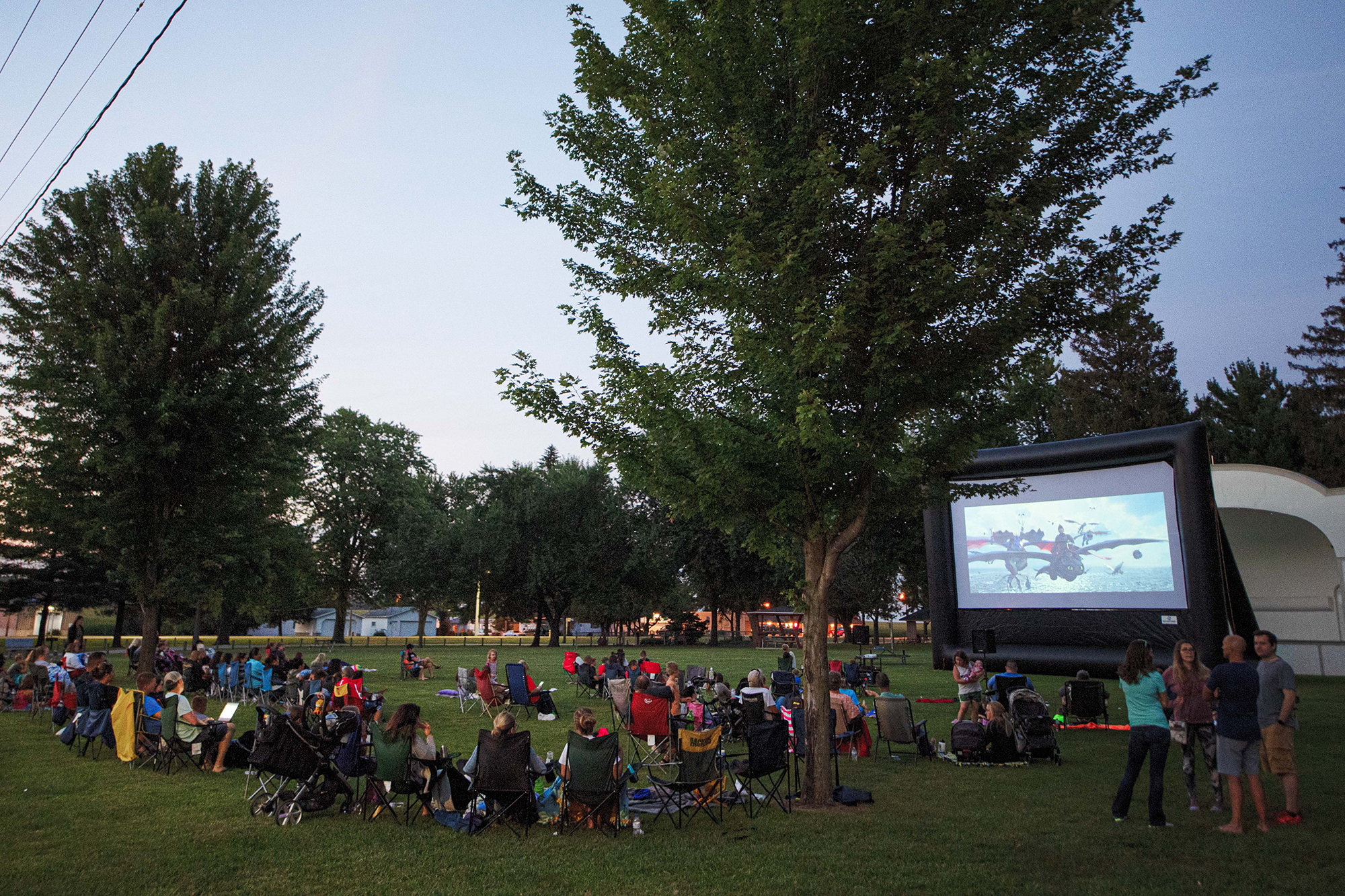 a portable movie theater shows a film in a park in new hampton; the business has its roots in a university of iowa innovation program