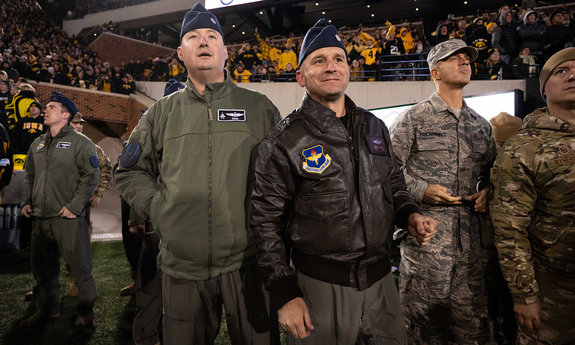 university of iowa alumni Lt. Col. Michael Lynch and Lt. Col. Nicholas Edwards on the sidelines at Kinnick Stadium