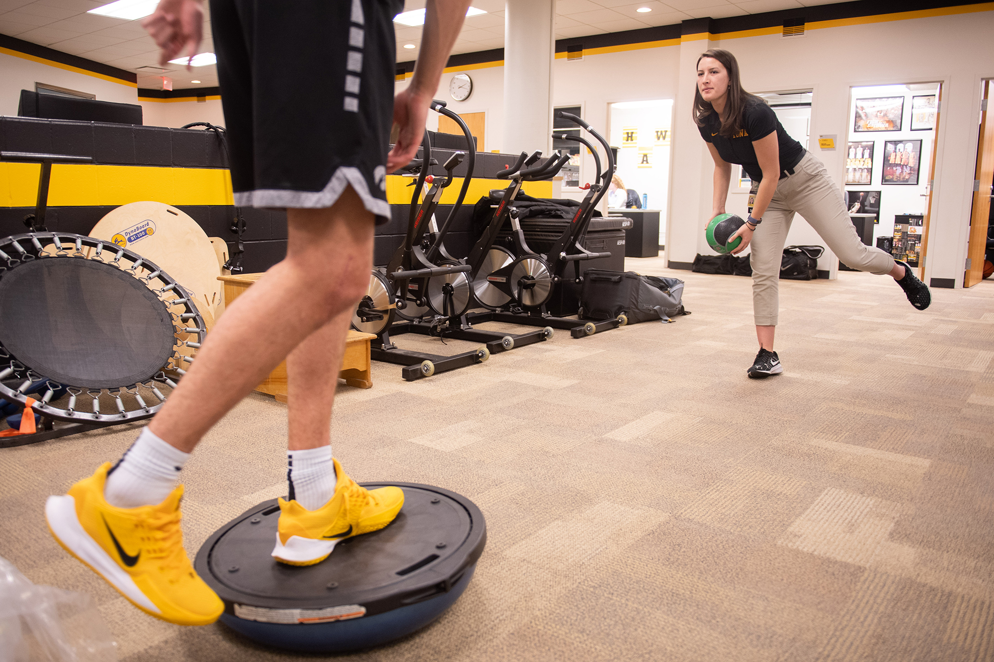 University of Iowa athletic training student Zoe Hicks works with a basketball player