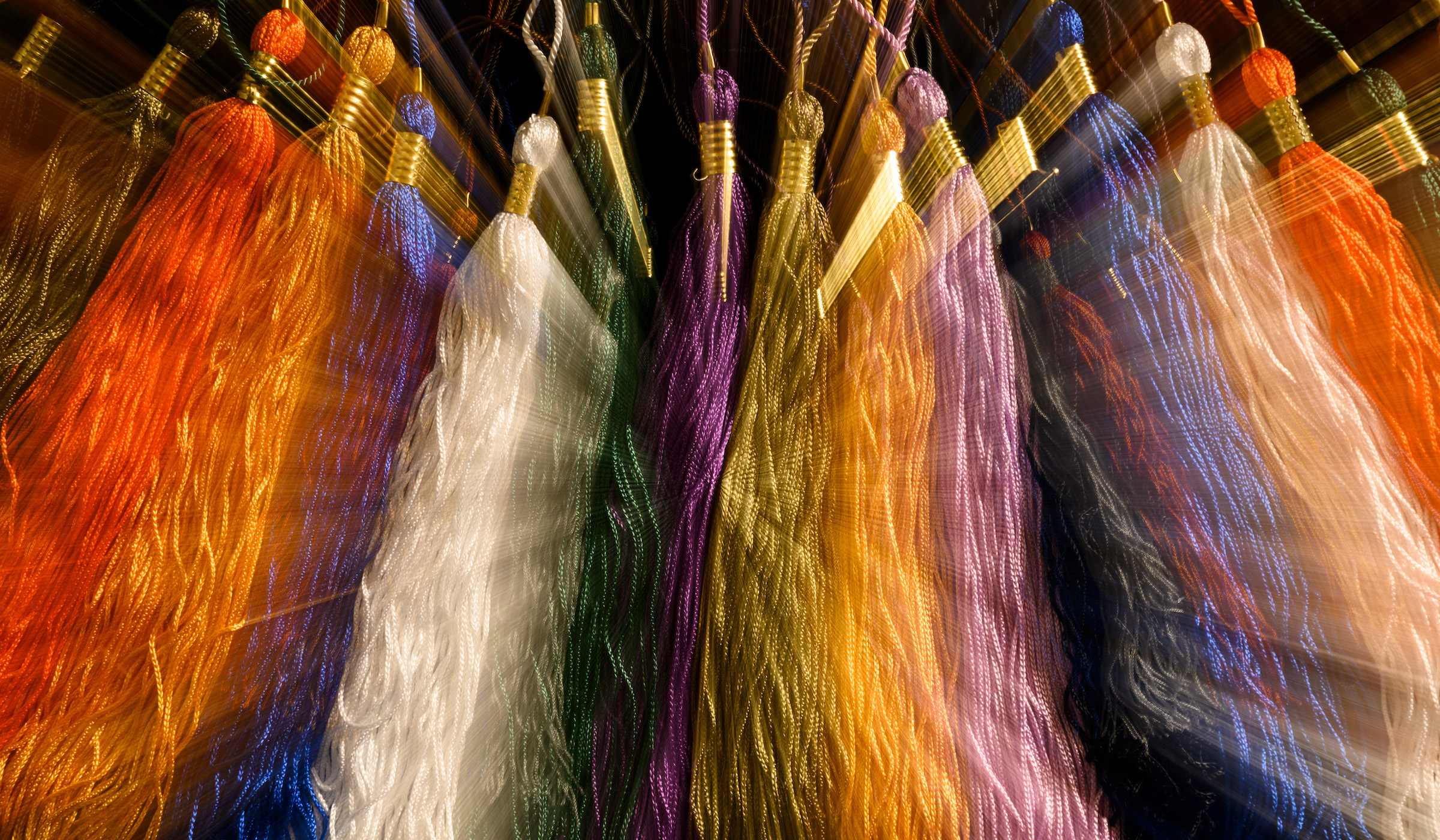 Multiple colored tassels in a row