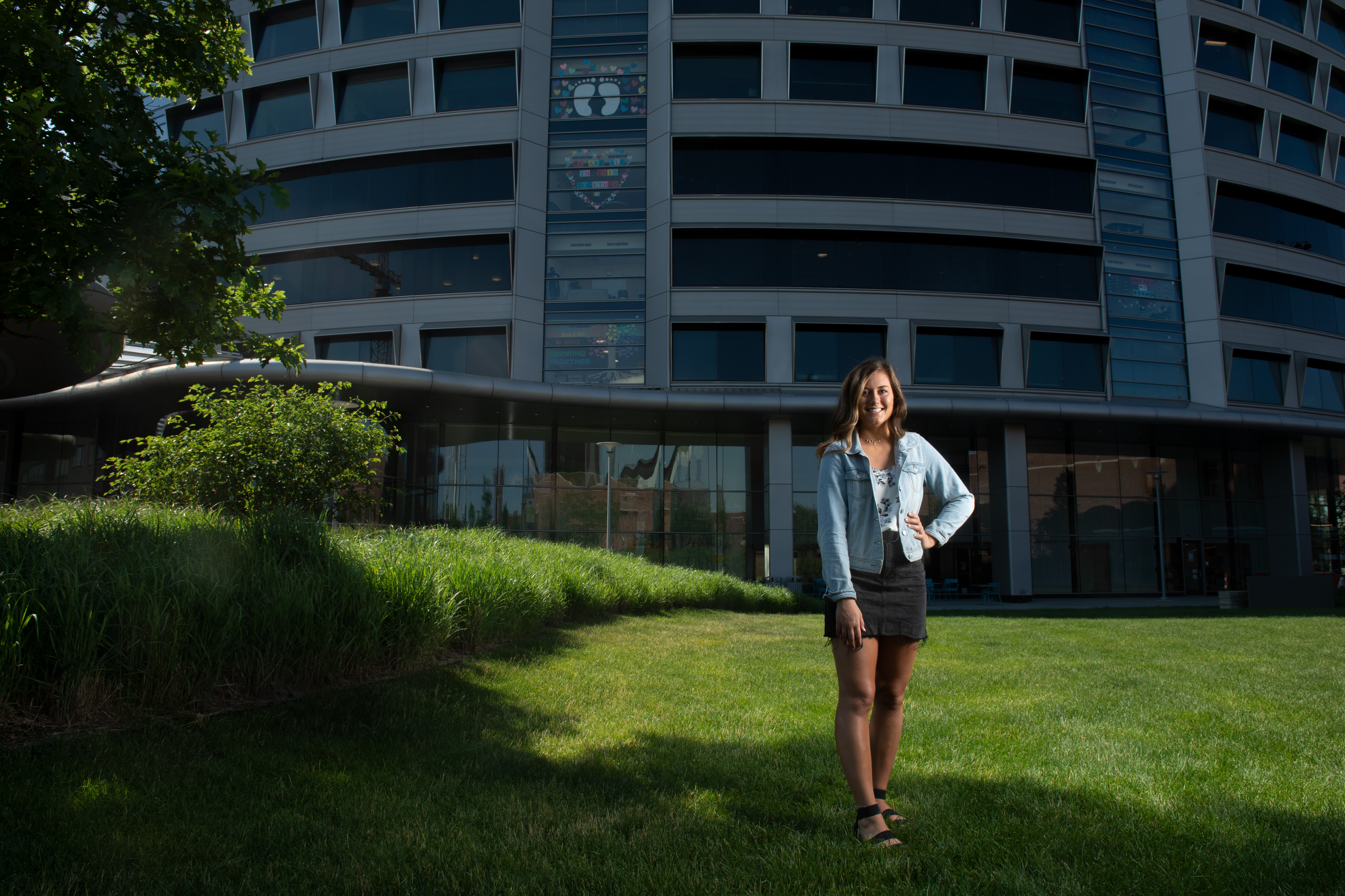Hannah Bormann stands in front of University of Iowa Stead Family Children's Hospital, where she received cancer care as a teen and where she will work as a nurse starting in August 2020