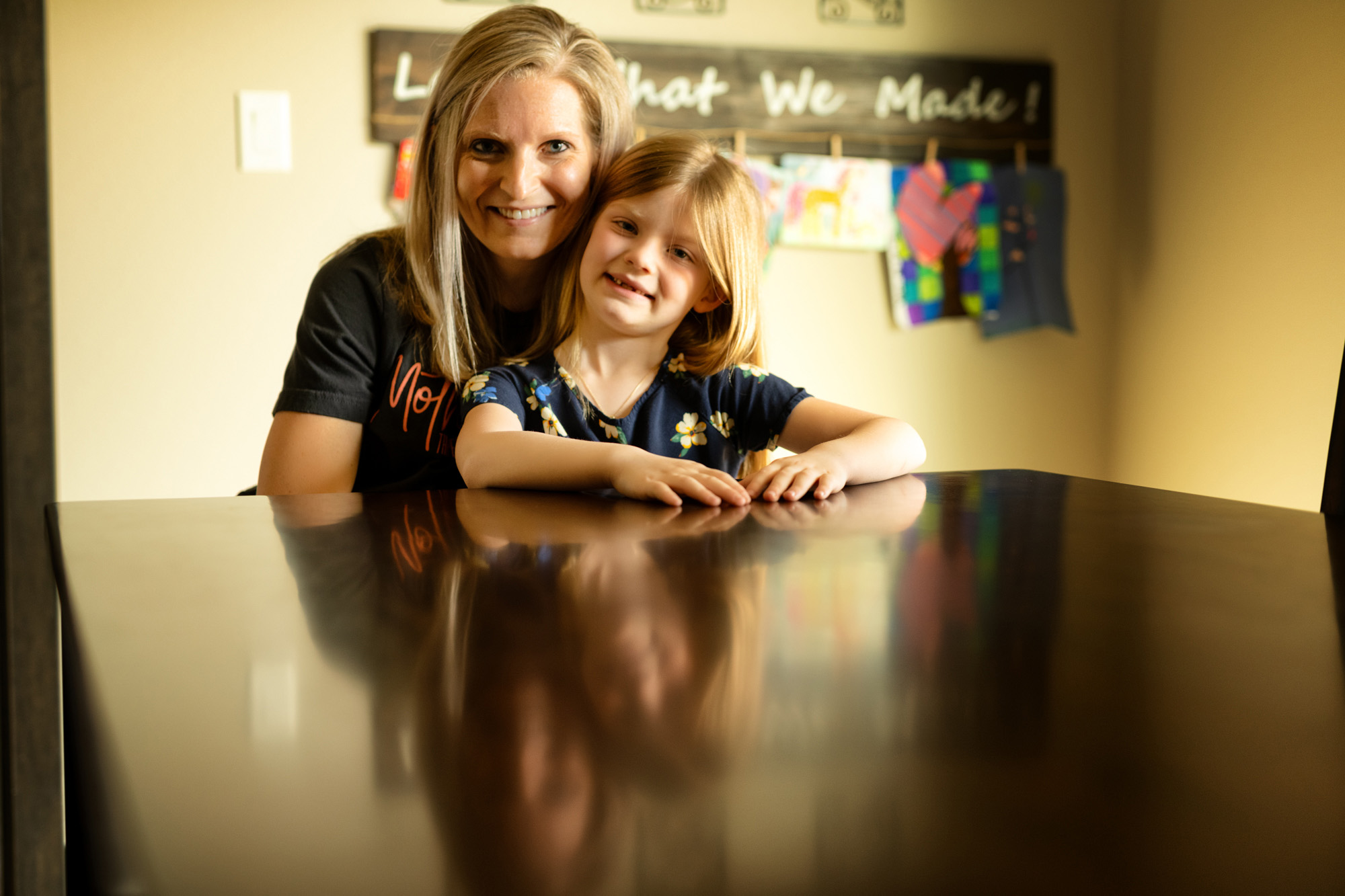 Sahara McCulley sitting at a table with her mother, Alexa