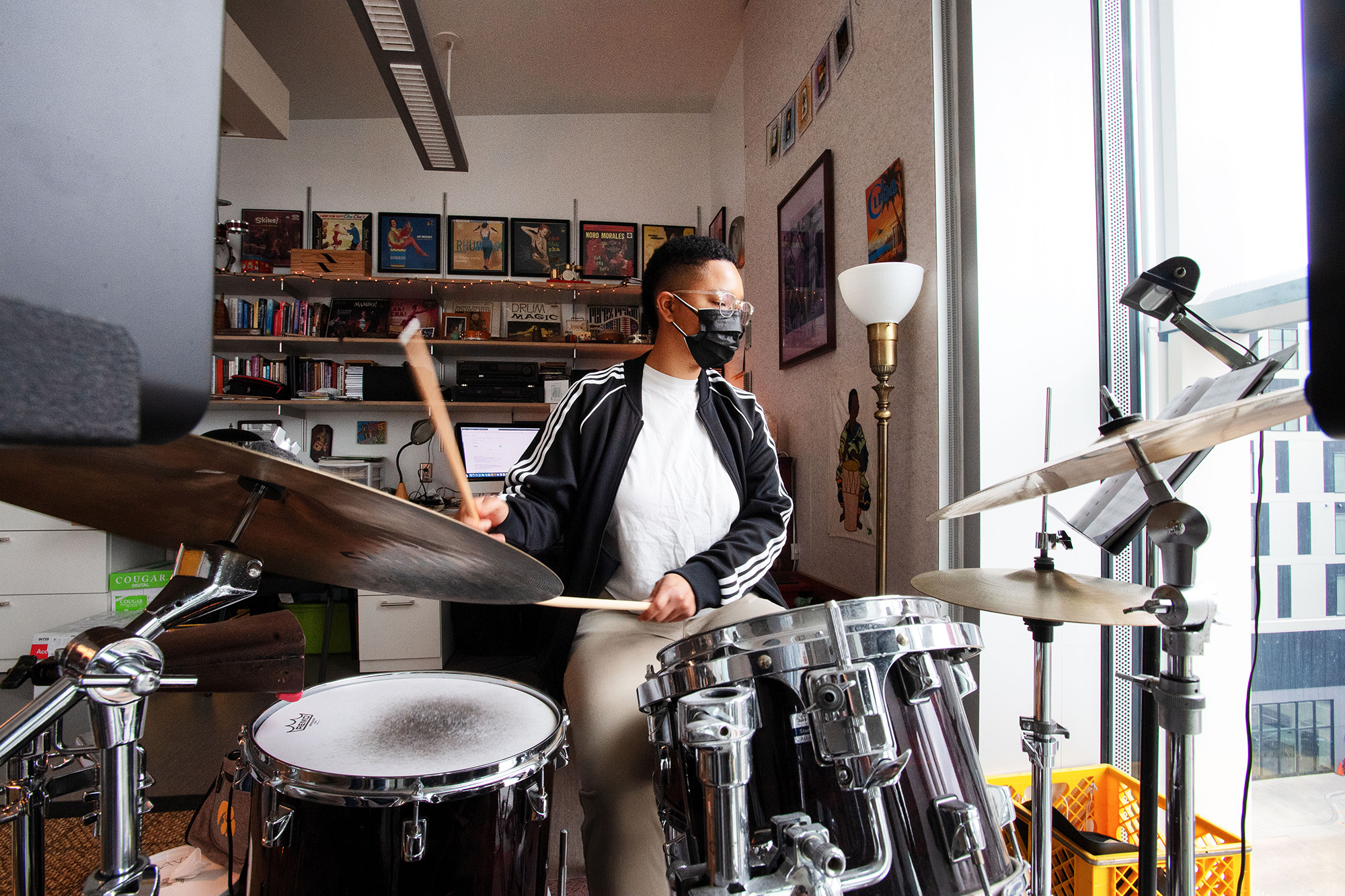 University of Iowa graduate student Giauna Neville on drums in a faculty studio