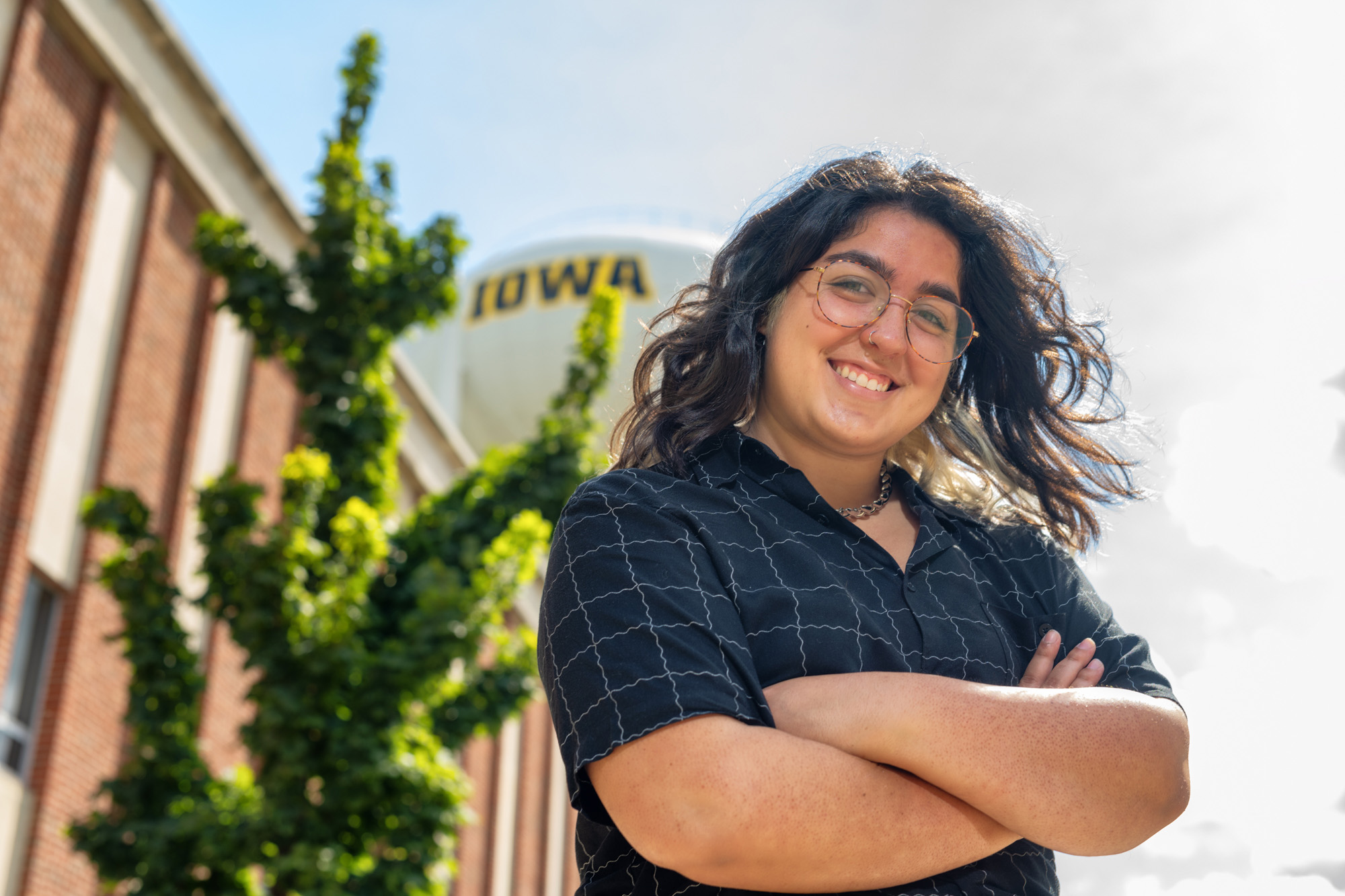 University of Iowa graduate student Bianca Robles-Munoz standing on the Iowa campus, near the Wendell Johnson Speech and Hearing Clinic