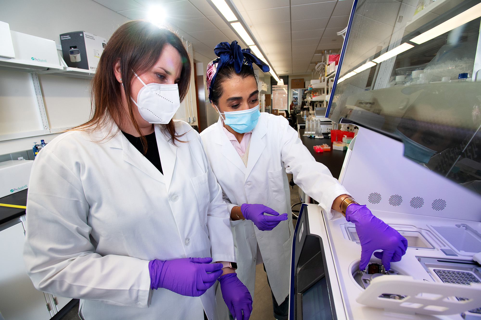 a faculty member and a student work in a lab in the University of Iowa College of Pharmacy building