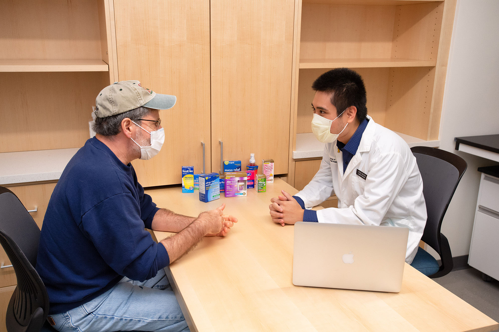 a University of Iowa pharmacy student meets with a simulated patient in the Pharmacy Practice Learning Center in the College of Pharmacy Building