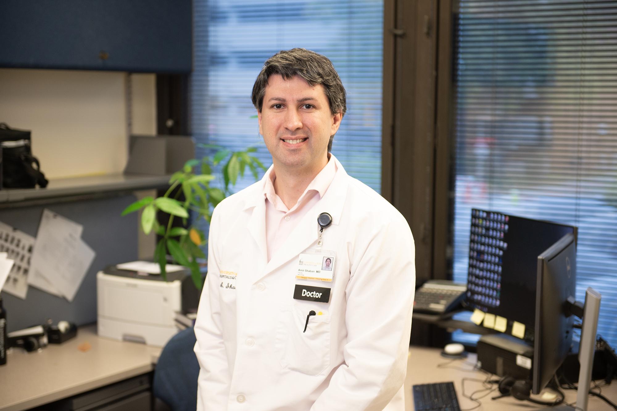 neurologist Amir Shaban, MD, in an office setting