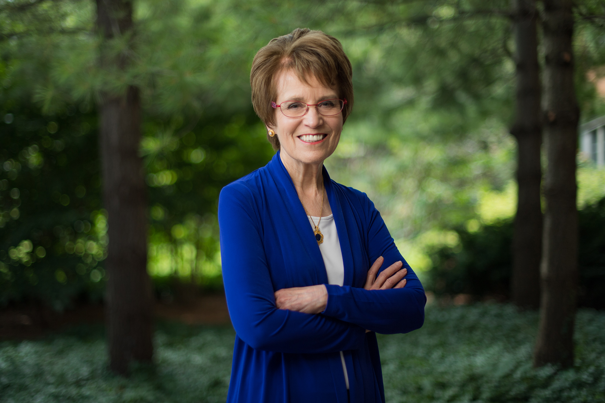 Former University of Iowa president Mary Sue Coleman posing outdoors for a portrait