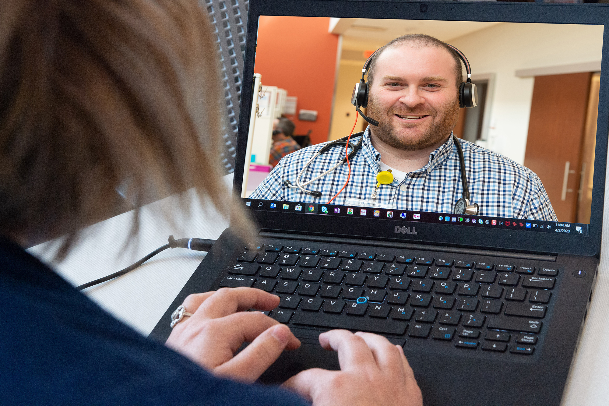 patient speaking with a health care professional via video call on a computer