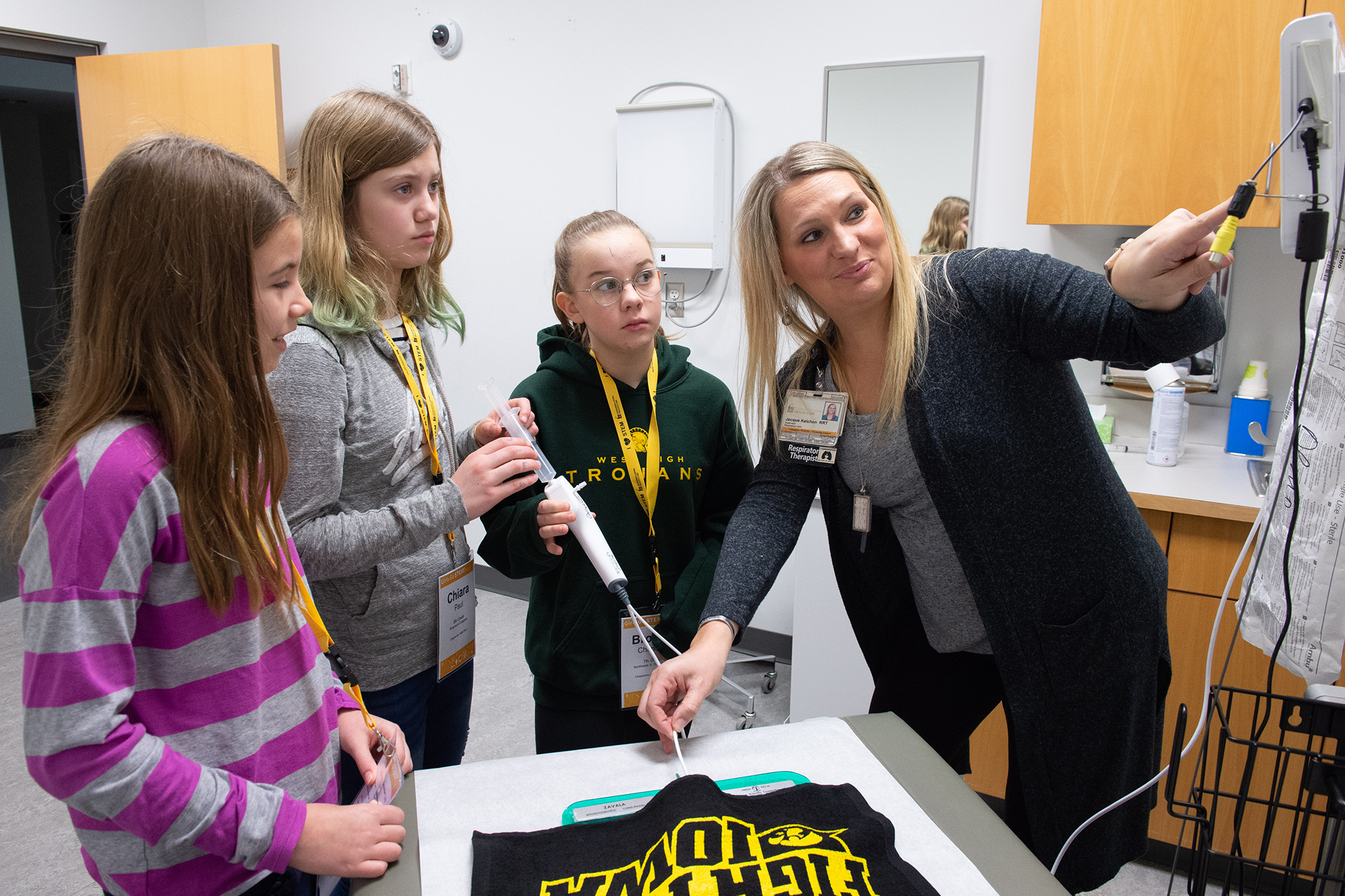 Girls Go STEM participants work with Jacque Kelchen, a respiratory care supervisor at University of Iowa Hospitals and Clinics