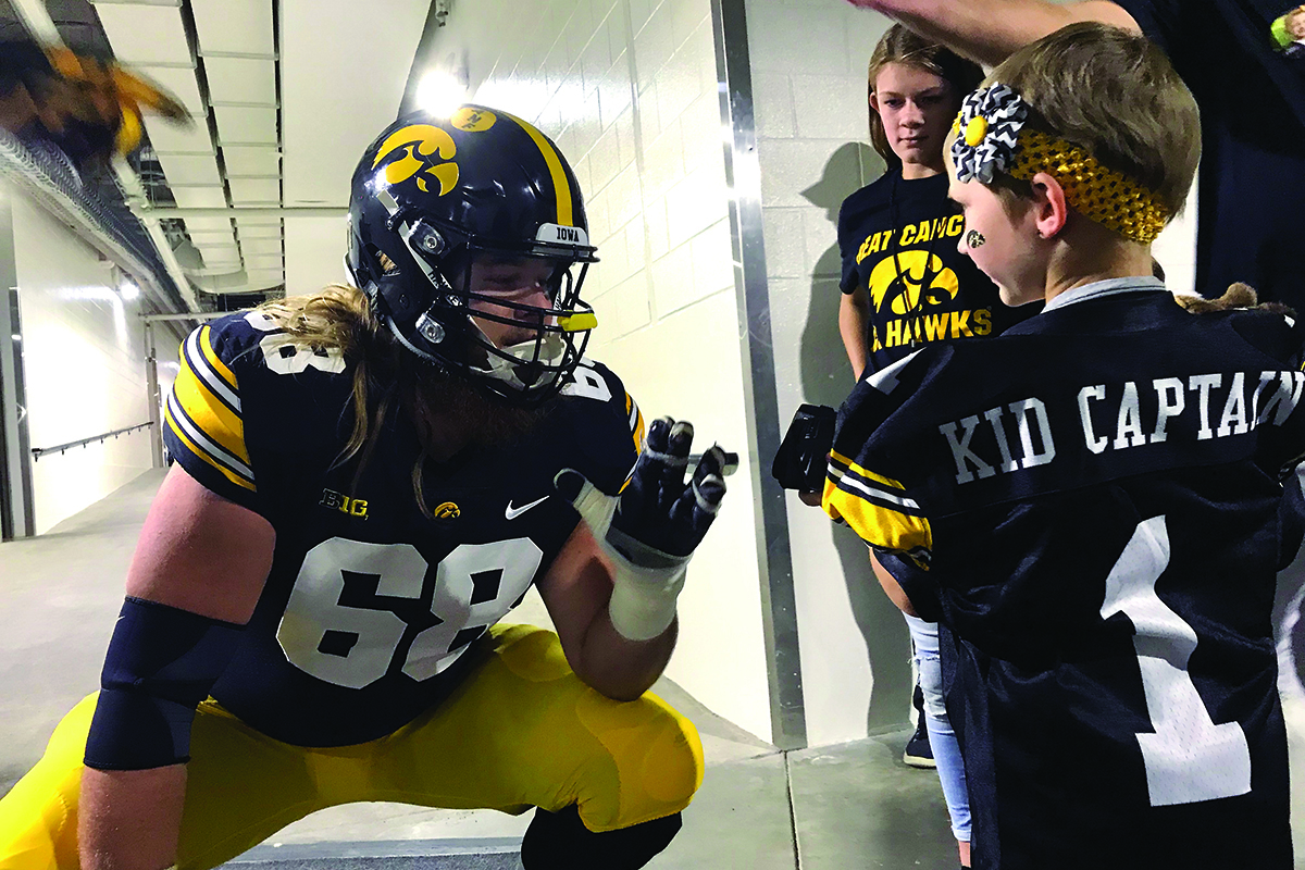 university of iowa football player and kid captain honoree