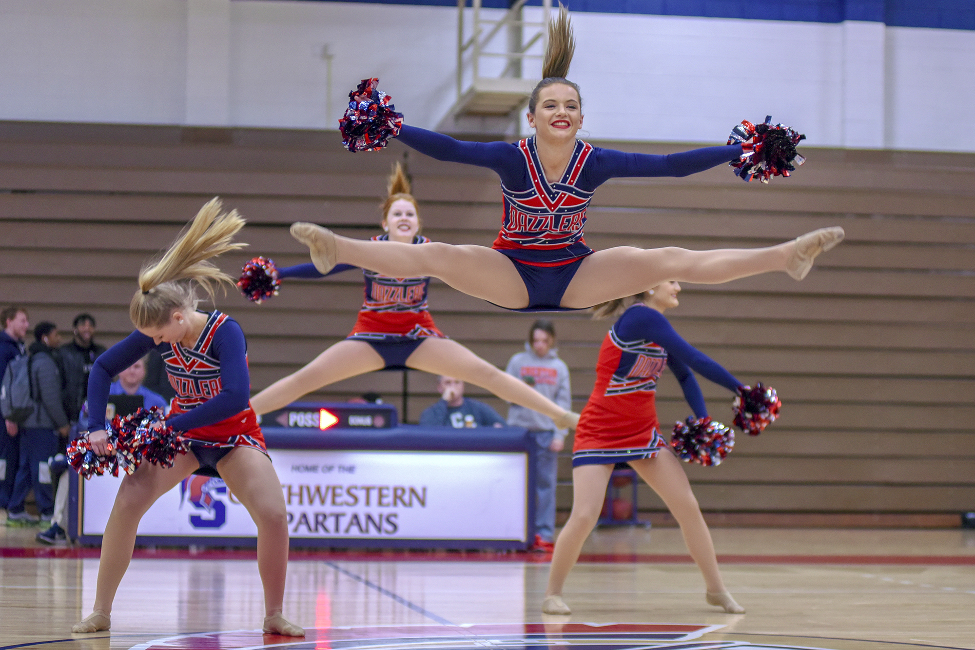 Kiersten Latham leaps into the air during a dance routine at Southwestern Community College in Creston, Iowa. Kiersten