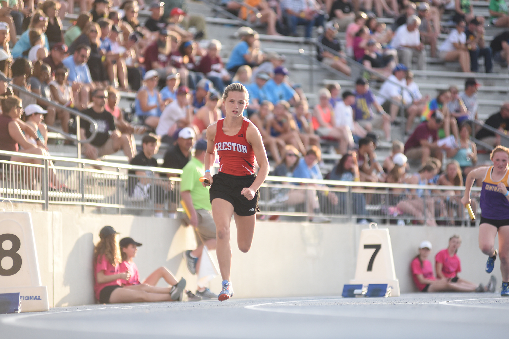 Kiersten Latham runs at the Iowa State Track Meet during her days at Creston High School