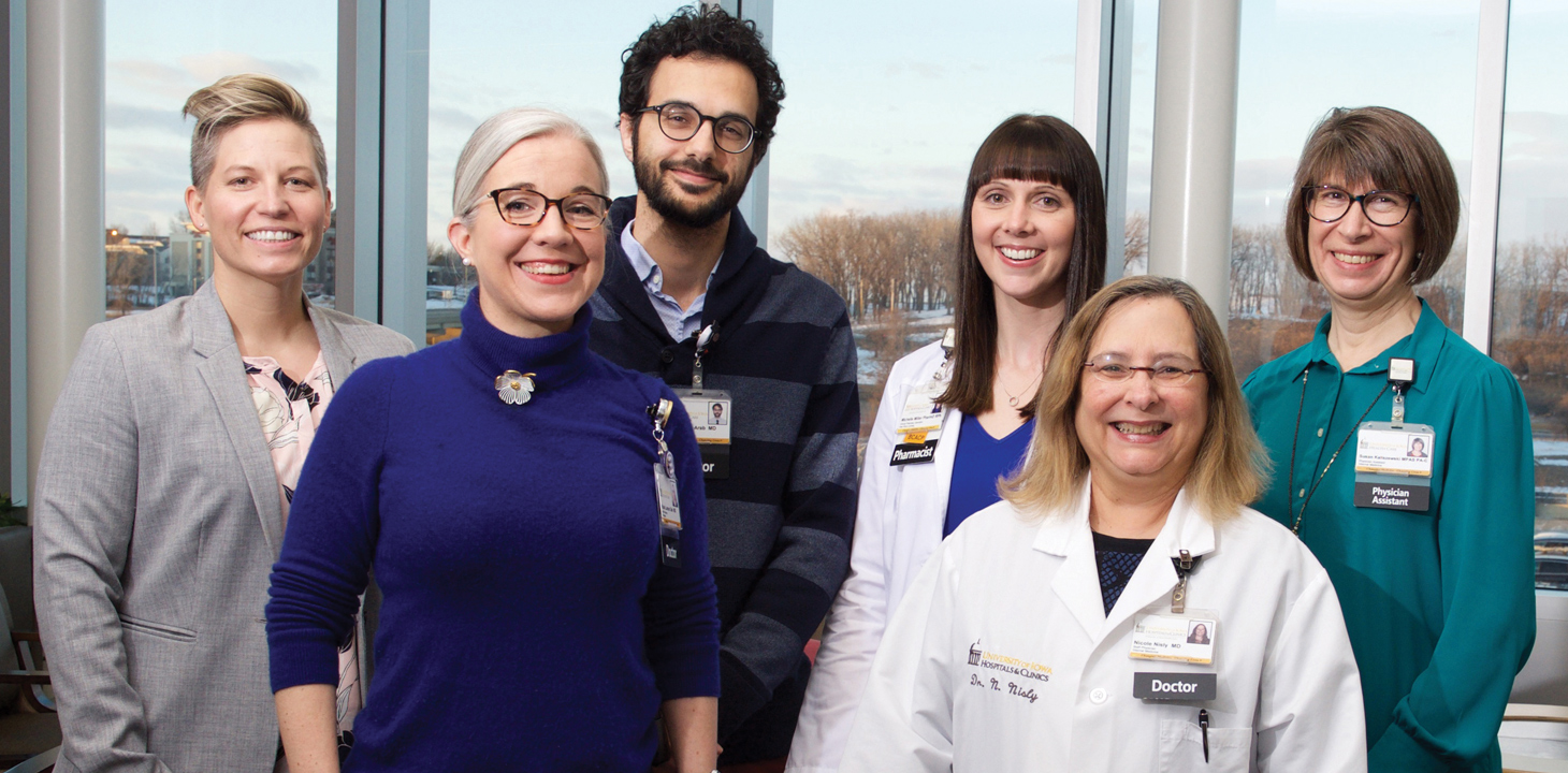 UI LGBTQ Clinic health care providers include, from left, Dr. Katherine Imborek (08MD, 11R), Dr. Katie Larson Ode, Dr. Emad Abou-Arab, pharmacist Michelle Miller, Dr. Nicole Nisly (93R), and physician assistant Susan Kaliszewski (91MS, 92MPA).