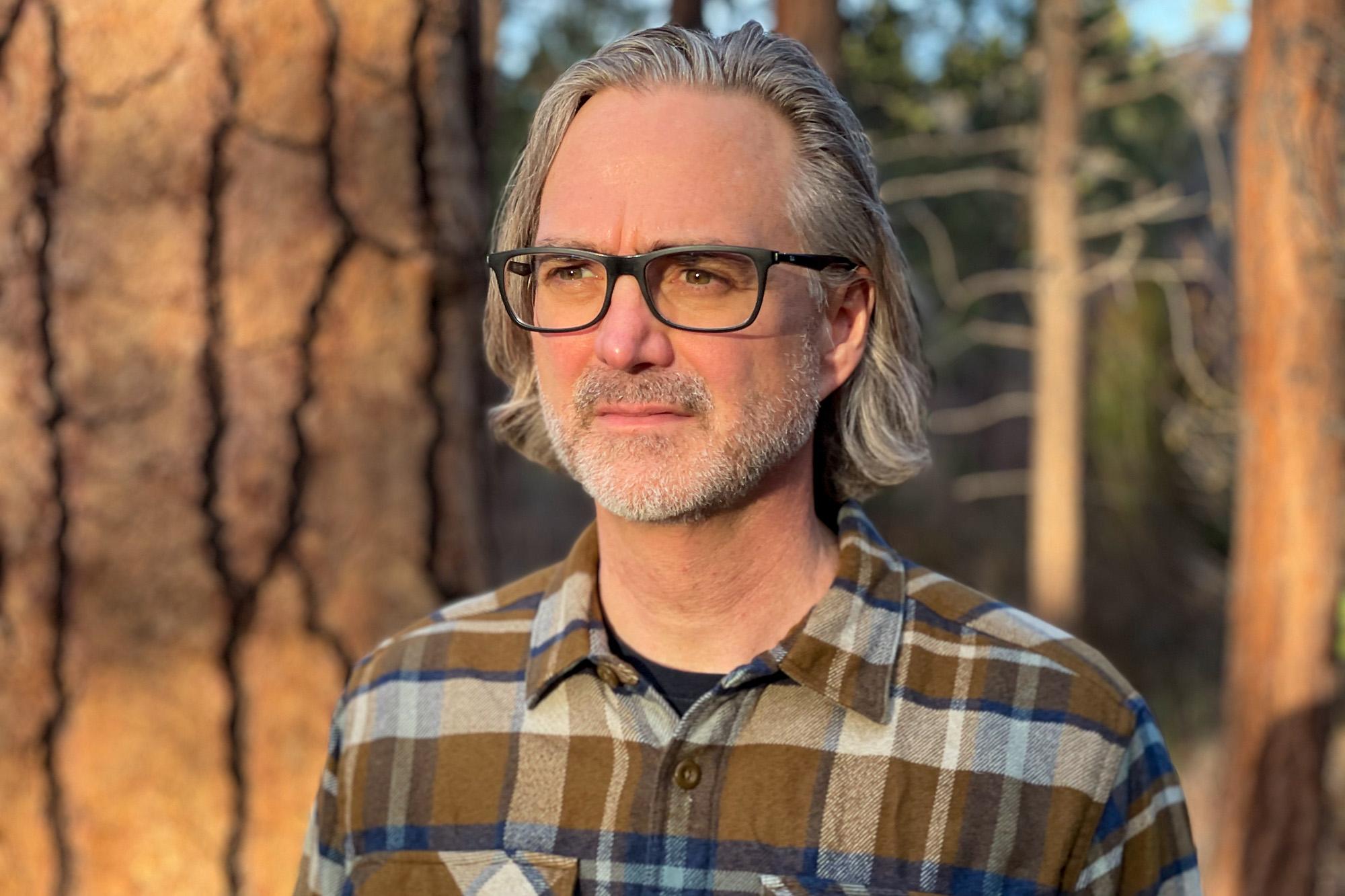 University of Iowa alumnus and film producer Michael Scheuerman outdoors in Oregon