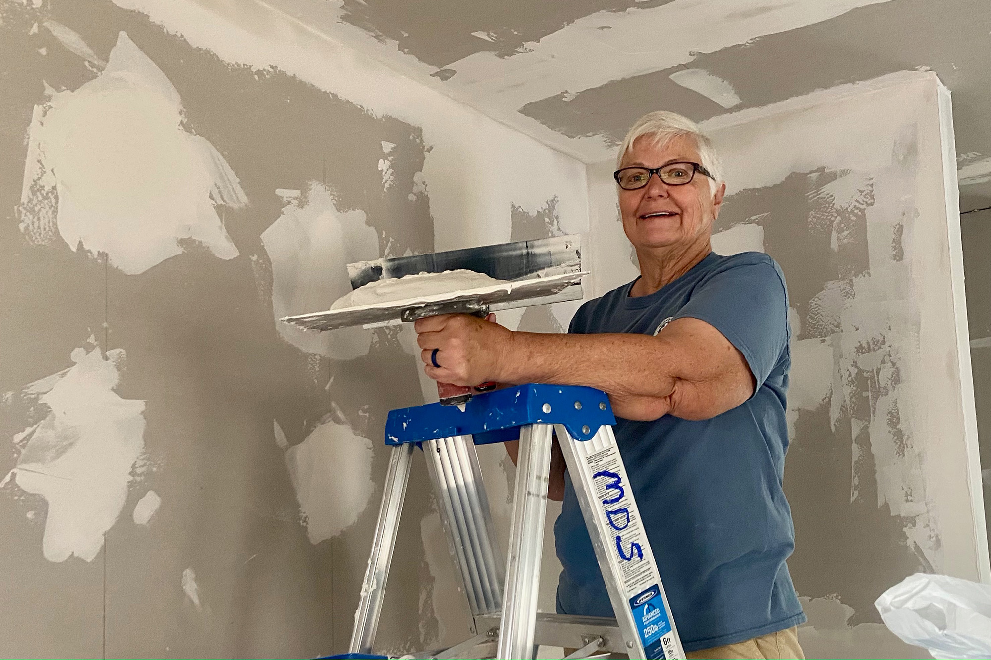 Rita Wolf, of Monticello, Iowa, loves spending winters with her husband Ken on volunteer mission trips to repair and rebuild homes after disasters