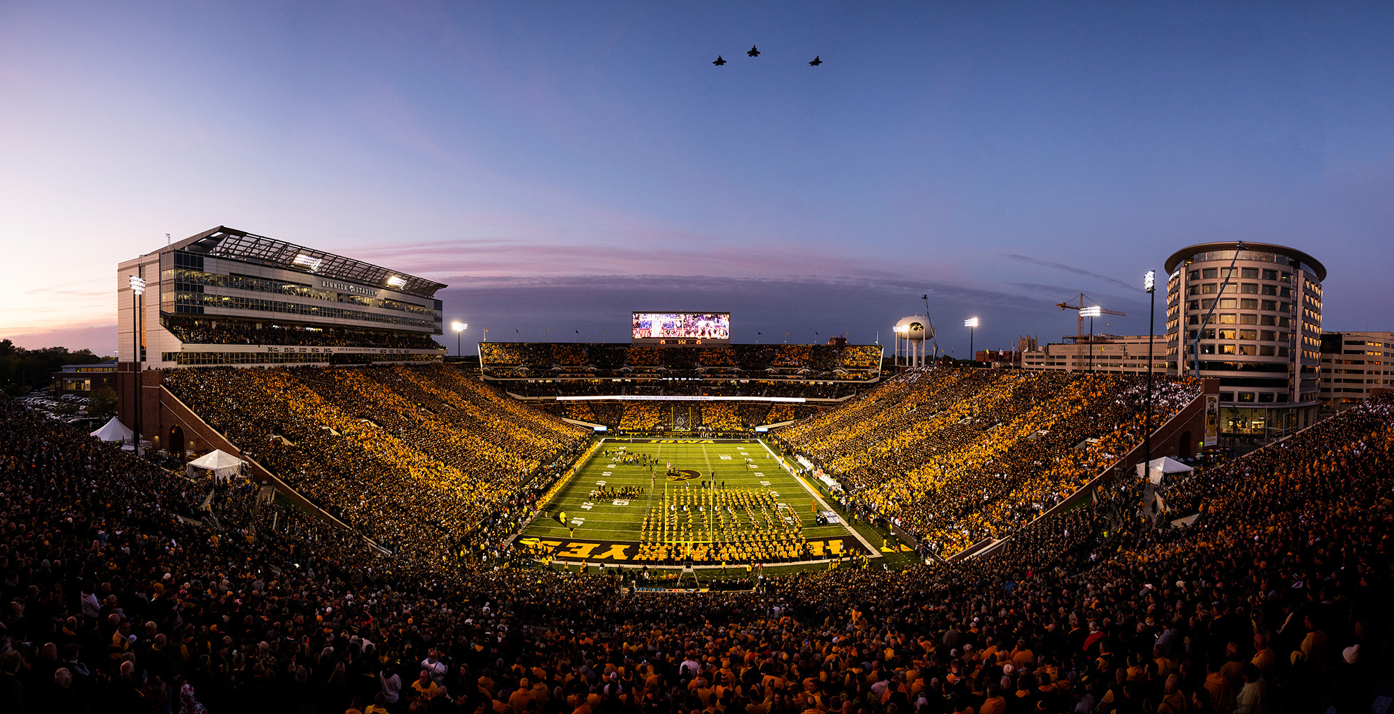 Air Force pilots, including University of Iowa alumni Michael Lynch and Nicholas Edwards, fly over Kinnick Stadium