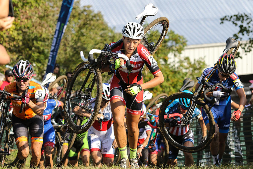 competitors carry their bikes at Jingle Cross in Iowa City