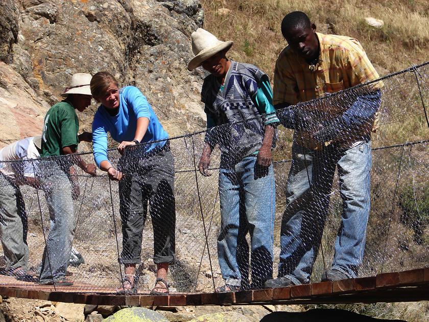 university of iowa alumna avery bang working on a footbridge in Peru