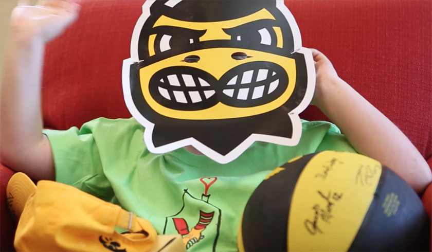 brady jorgensen, a patient at university of iowa stead family children's hospital, wears a herky mask during an interview