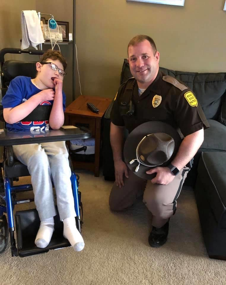 Caleb Helland with Iowa State Patrol trooper Robert Sankey
