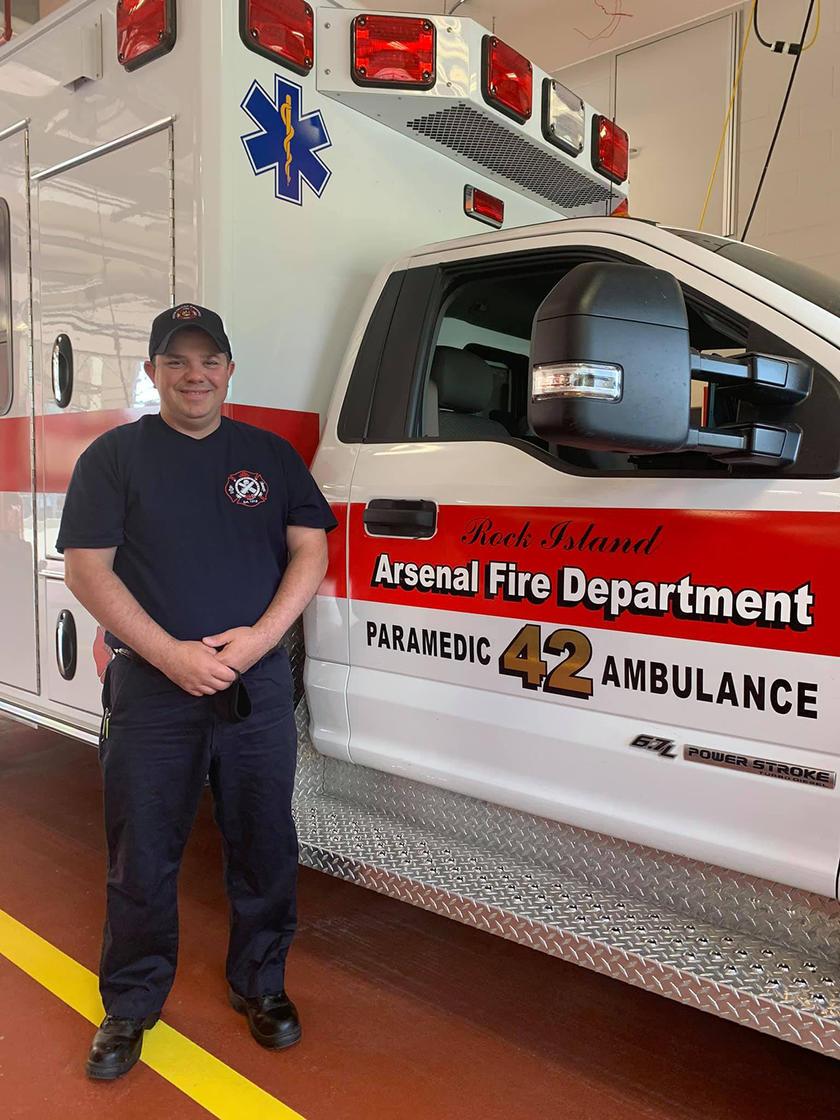 Paul Sereda standing near an ambulance
