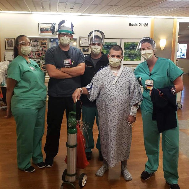 Paul Sereda standing with members of the intensive care unit staff