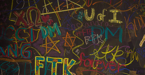"chalk art for University of Iowa Dance Marathon, including the slogan FTK, or ""for the kids"""