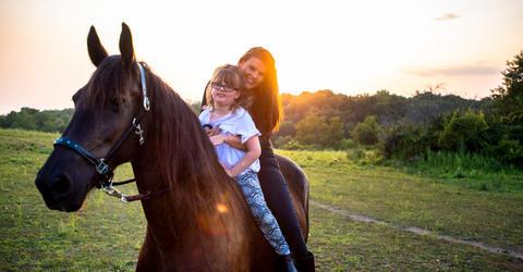 Nevaeh and Kari Brock on one of their horses