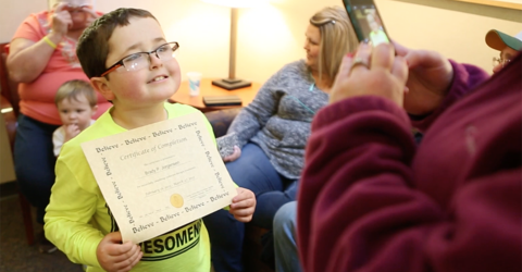 brady jorgensen, a patient at university of iowa stead family children's hospital, holds a certificate of completion