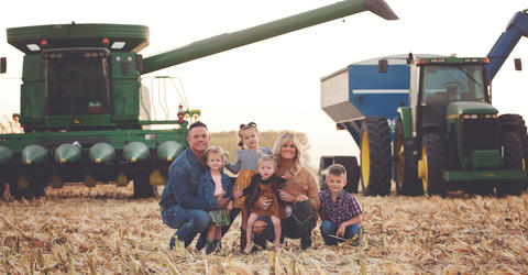 the gardner family of woden, iowa, in the fields on their family farm