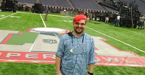 university of iowa alumnus Lucas Ingram on the field before Super Bowl LI