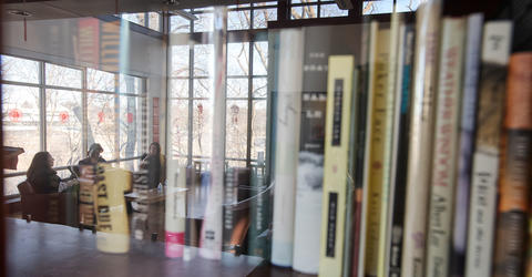 books on a shelf in the Dey House, home of the iowa writers' workshop