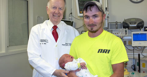 Dr. Edward Bell with Kyle and Jaeden Nelson at University of Iowa Stead Family Children's Hospital NICU