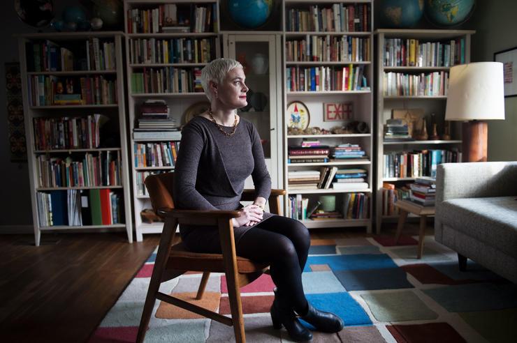 Inara Verzemnieks sits in her living room