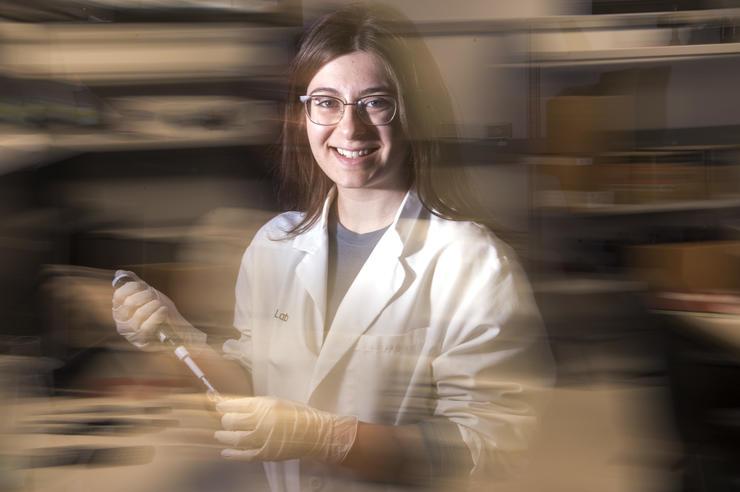 University of Iowa graduate Mikaela Mallin in the laboratory