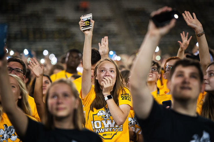 students waving to the children's hospital during kinnick at kickoff