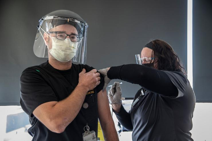 University of Iowa nurse receiving COVID-19 vaccination