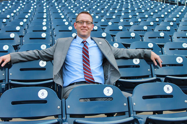 UI alumnus Joe Dwello sitting in seats at Washington Nationals ballpark