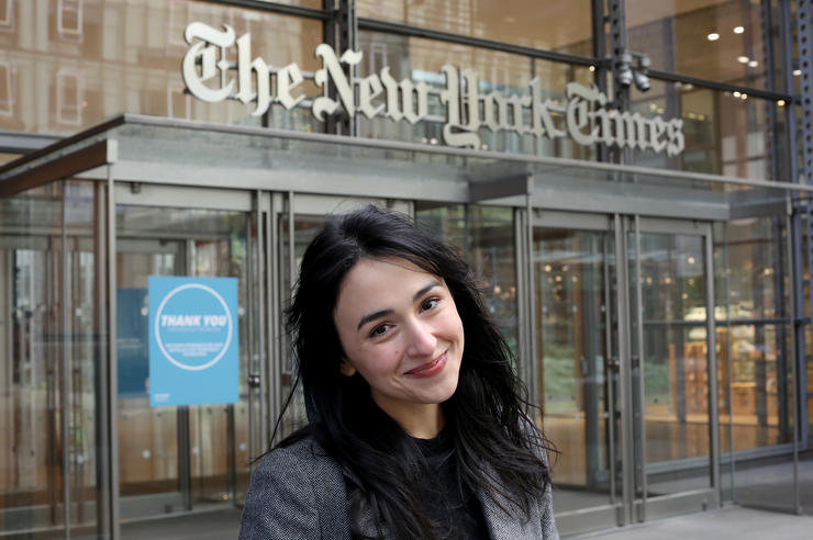 University of Iowa alumna Asmaa Elkeurti stands in front of the New York Times building, where she works as a software engineer