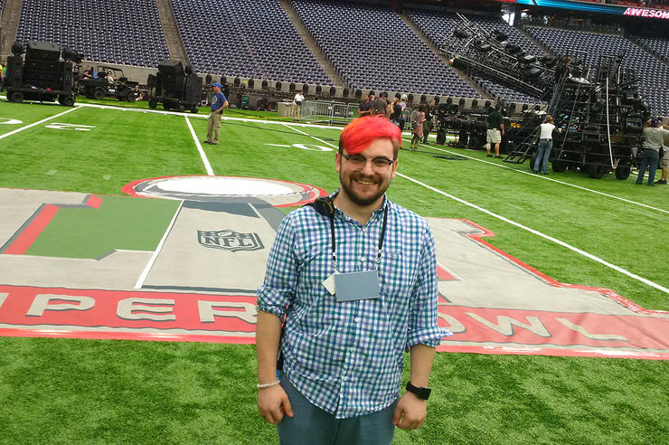 university of iowa alumnus Lucas Ingram on the field before Super Bowl LI