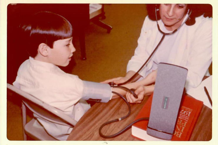 A child's blood pressure reading is taken in 1977 for the Muscatine Heart Study