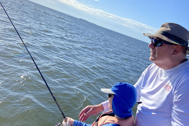 Owen Shunkwiler fishing with his grandchild