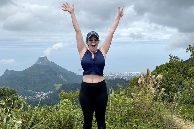 Rebekah Hall raising her arms in Brazil