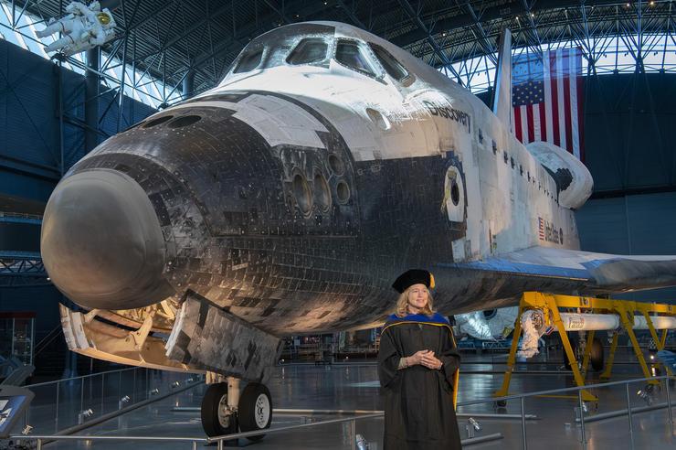 Ellen Stofan standing in front of shuttle