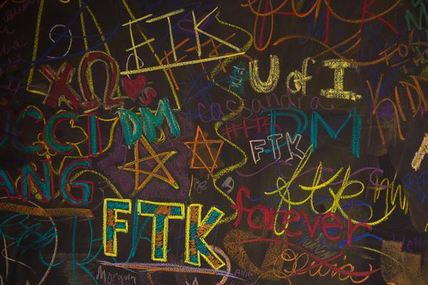 "chalk art for University of Iowa Dance Marathon, including the slogan FTK, or ""for the kids"""