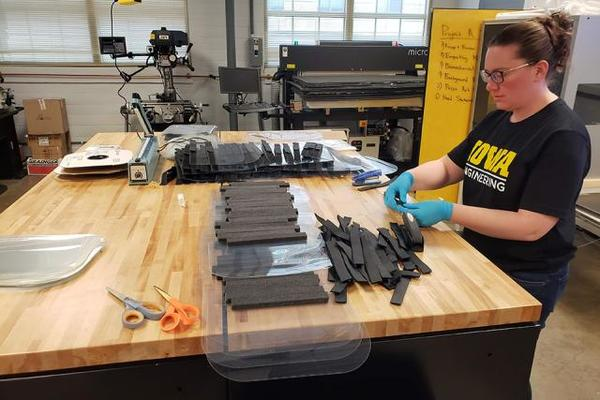 University of Iowa College of Engineering faculty member working on face shields